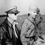 Vice Admiral Arthur D. Struble, General of the Army Douglas MacArthur, and Major General Oliver P. Smith inspecting the Inchon port area (Inchon, Korea: September 16, 1950)