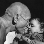 Mohandas K. Gandhi and child