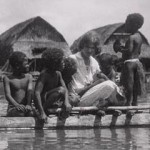 Margaret Mead on a canoe with Manus children (Pere, Manus Island, Admiralty Islands: 1928)