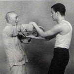 Yip Man and Bruce Lee practicing Wing Chun.
