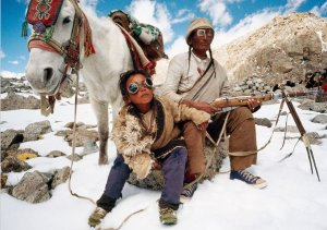 A Tibetan father and son on a pilgrimage around China's Mount Kailas